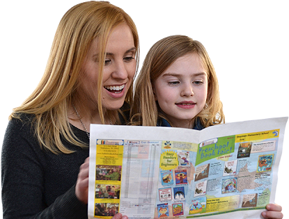 Photograph of an adult and a child reading a printed bookfair catalog created by Matchbook Marketing.